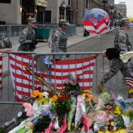 Flowers, flags and balloons at a memorial in Boston near the site of Monday's explosions.