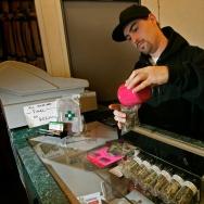 Alternative Herbal Health Services worker Jason Beck packages medical marijuana in San Francisco, California.