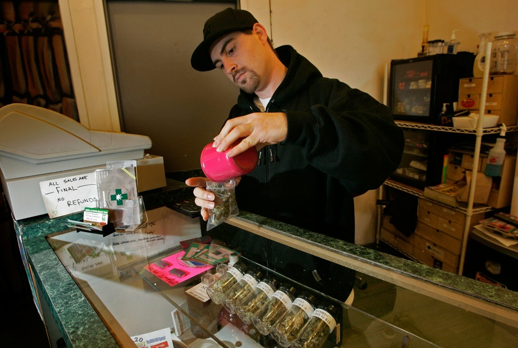 File: An employee at a medical marijuana dispensary.
