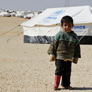A Syrian refugee boy stands outside his tent at Al Zaatri refugee camp in the Jordanian city of Mafraq, near the border with Syria, earlier this week.