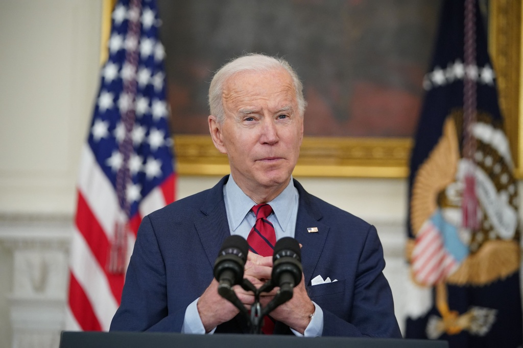 US President Joe Biden speaks about the Colorado shootings in the State Dining Room of the White House in Washington, DC, on March 23, 2021.
