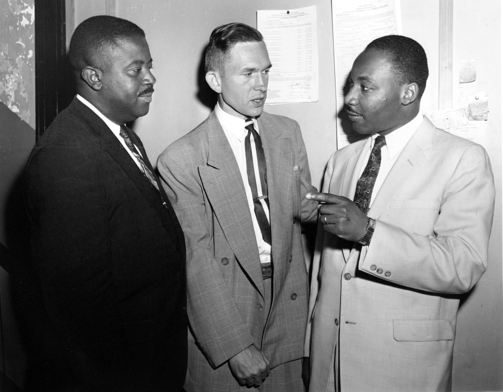 In this May 28, 1957, photo, Rev. Robert S. Graetz, center, Rev. Dr. Martin Luther King Jr. and Rev. Ralph D. Abernathy, left, talk outside the witness room during a bombing trial in Montgomery, Ala. Graetz, the only white minister to support the Montgomery Bus Boycott, died Sunday, Sept. 20, 2020. He was 92.