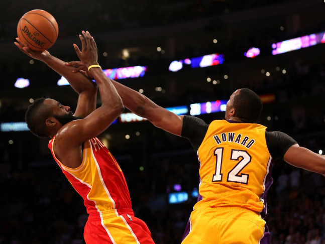 James Harden #13 of the Houston Rockets shoots over Dwight Howard #12 of the Los Angeles Lakers at Staples Center on April 17, 2013 in Los Angeles, California. The Lakers won 99-95 in overtime.