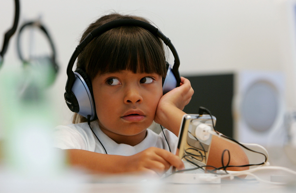 Six-year-old Emma Cordell listens to a new iPod on display at the Apple Store in San Francisco, California.
