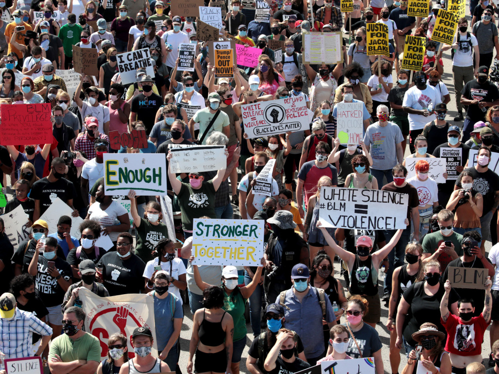 People march in support of Jacob Blake and his family to the Kenosha County Courthouse on in August in Kenosha, Wisconsin.