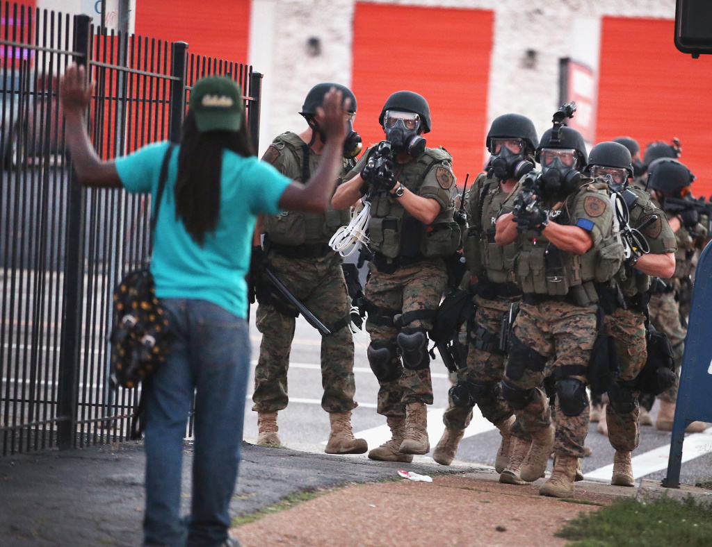 Police force protestors from the business district into nearby neighborhoods on Aug. 11, 2014 in Ferguson, Missouri.
