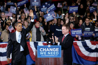 File photo: Barack Obama (L) waves to supporters as Sen. Jim Webb (D-VA) looks on during a campaign rally at Verizon Wireless Virginia Beach Amphitheater October 30, 2008 in Virginia Beach, Virginia.