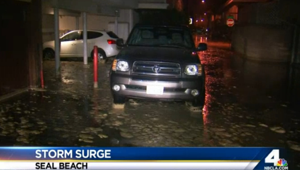 A storm surge generates high surf and leads to flooding in Southern California coastal communities, including Seal Beach.
