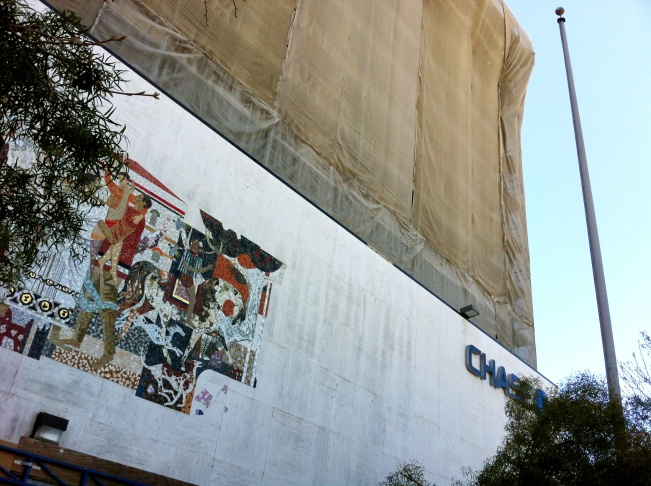 No, this isn't a Christo art project; it's the Chase Bank Tower in Pomona, which is threatened with demolition, despite its Millard Sheets pedigree, including the mosaic on the left.
