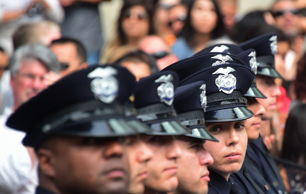 Police recruits attend their graduation ceremony at LAPD Headquarters where rappers Snoop Dogg and The Game led a peaceful demonstration outside on July 8, 2016 in Los Angeles, California, in what they called an effort to promote unity in the aftermath of the deadly shootings of police officers in Dallas.   / AFP / Frederic J. BROWN        (Photo credit should read FREDERIC J. BROWN/AFP/Getty Images)