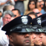 Police recruits attend a recent graduation ceremony at LAPD Headquarters   (Photo credit should read FREDERIC J. BROWN/AFP/Getty Images)
