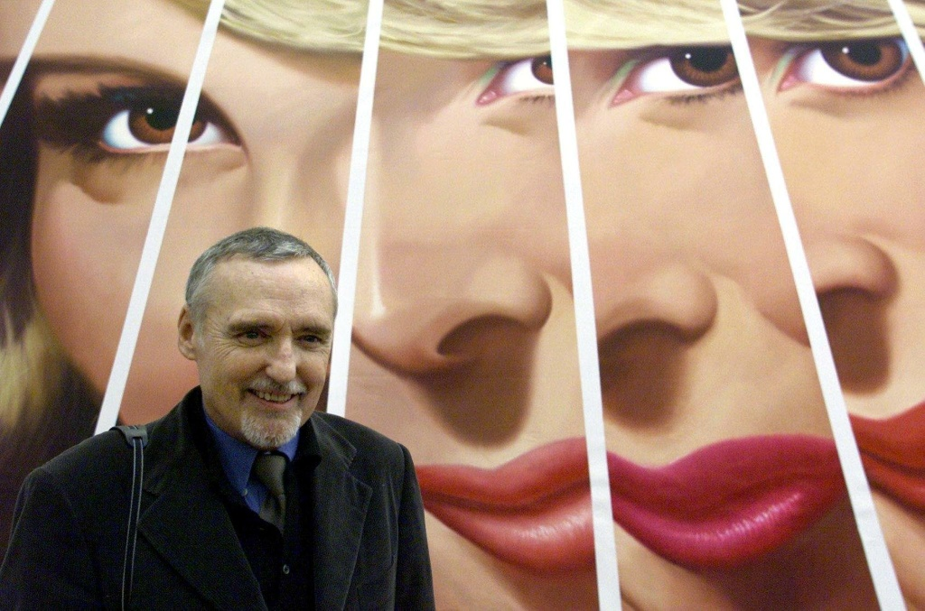 US actor and director Dennis Hopper poses in front of one of his art-works in the Stedelijk Museum in Amsterdam, 15 February 2001. The exhibition