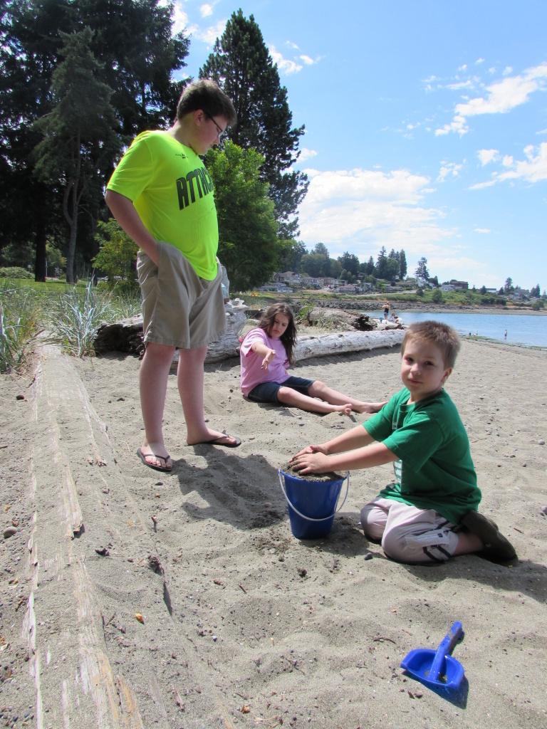 Three members of the Owen family - Chandler, Emily, and Joshua - take a homeschool 'field trip' to Sunnyside Beach, Wash.