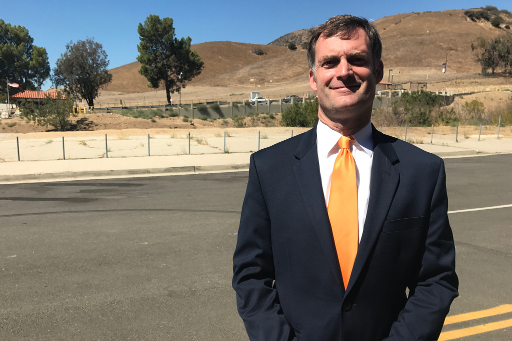 Darrell Park, a candidate for the  LA County District 5 supervisor seat, outside the entrance to the Aliso Canyon storage facility in Porter Ranch.