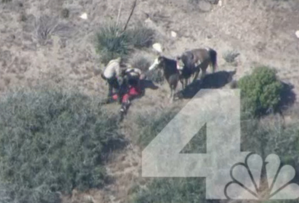 A screenshot from NBC video shows two sheriff's deputies attacking a man who had led them on a car chase before stealing a horse.