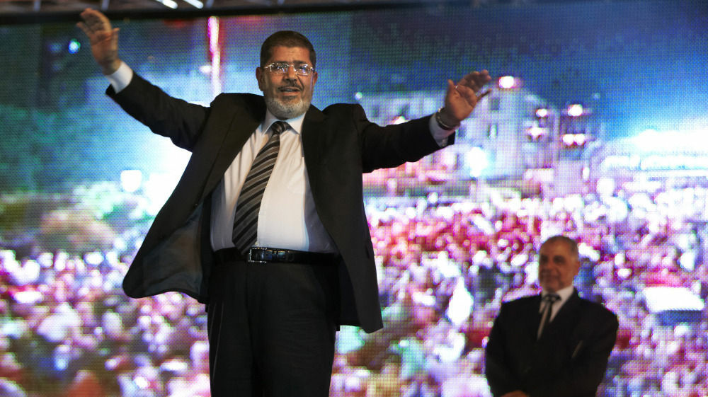Mohammed Morsi, the Muslim Brotherhood's presidential candidate, appears at a rally in Cairo.