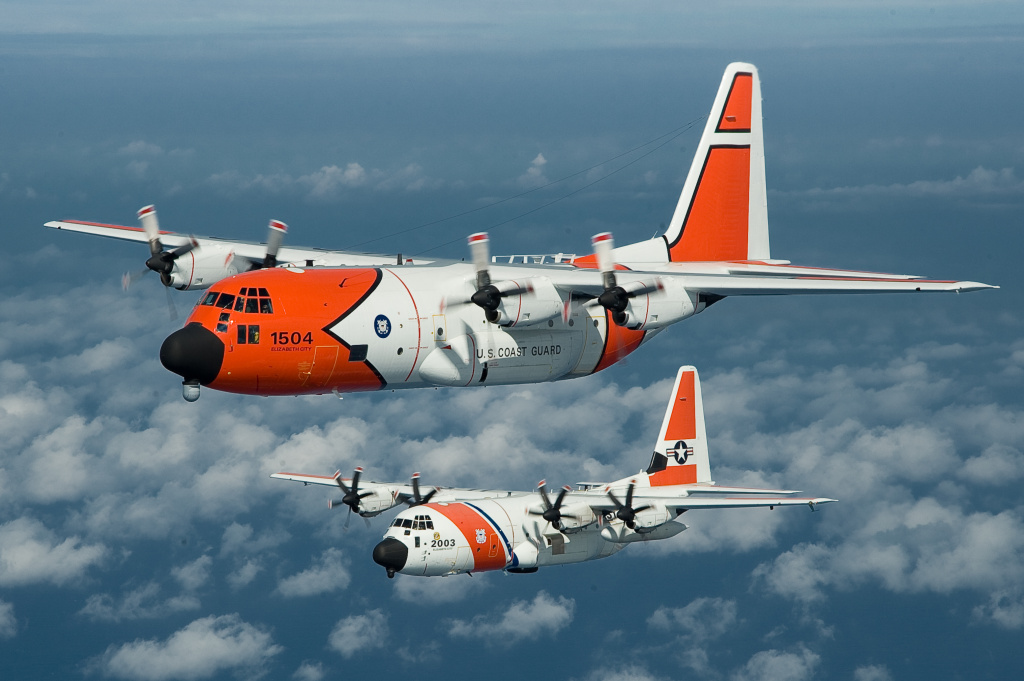 Two Coast Guard HC-130H airplanes in flight. The U.S. Senate recently passed a defense bill that transfers seven aircraft from the Coast Guard to the U.S. Forest Service to be used to fight wildfires.