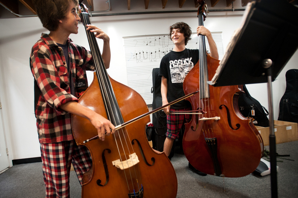 Tenth grader Emmet Webster and twelfth grader Aidan Faith play double bass at Renaissance Arts Academy in Eagle Rock. Music education has been linked to improving student IQ scores.
