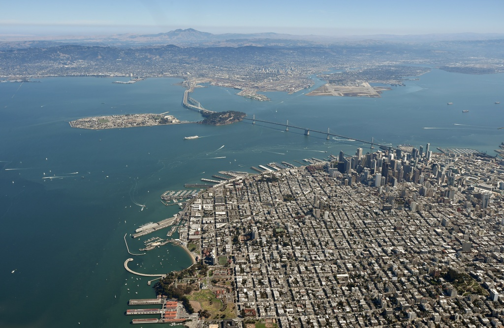 The Golden Gate Bridge and the San Francisco Bay are seen from above in San Francisco, California.