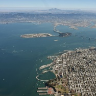 The Bay Bridge and the San Francisco Bay are seen from above in San Francisco, California. The Bay is also home to oyster habitat, which scientists say is threatened by climate change.