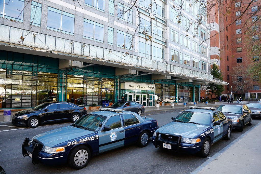 Boston Police and Massachusetts State Police stand guard outside of Beth Israel Deaconess Medical Center.