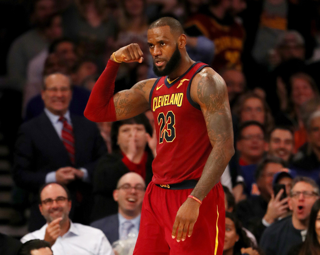 LeBron James of the Cleveland Cavaliers celebrates after he drew the foul in the second half against the New York Knicks at Madison Square Garden on November 13, 2017 in New York City.