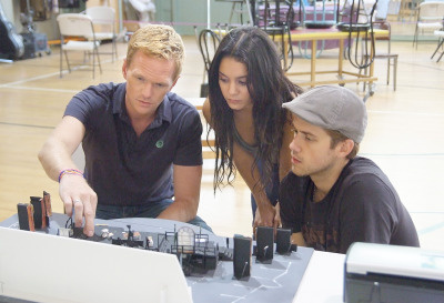 Director Neil Patrick Harris with Vanessa Hudgens as Mimi and Aaron Tveit as Roger in rehearsal for