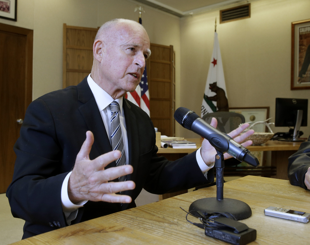 Gov. Jerry Brown discusses his re-election while taking with reporters at his Capitol office in Sacramento, Calif., Wednesday, Nov. 5, 2014. (AP Photo/Rich Pedroncelli)