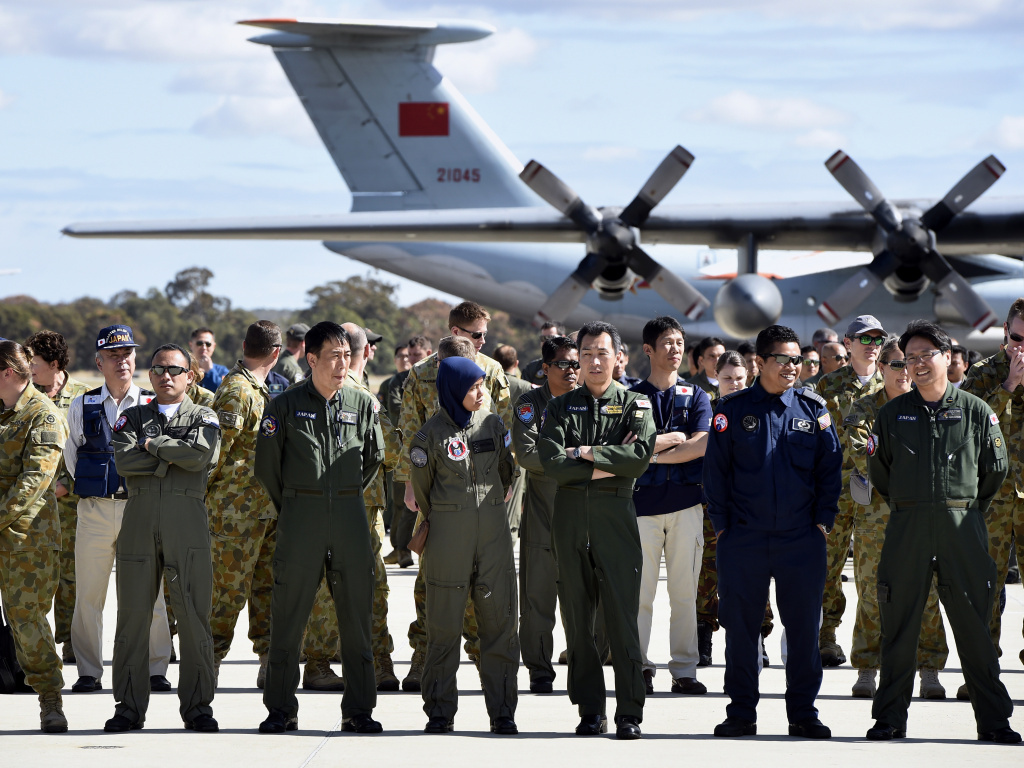 International and Australian air crews involved in the search for the missing Malaysia Airlines plane on the tarmac at the Royal Australian Air Force Pierce Base in Bullsbrook, near Perth, on Tuesday.
