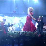 "A screenshot of Darlene Love and David Letterman touching after her final performance of ""Christmas (Baby Please Come Home)"" on his talk show."