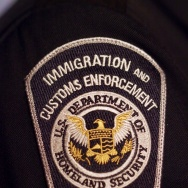 File: An Immigration and Customs Enforcement (ICE) badge on a uniform is viewed on March 5, 2014 at the preview of a temporary exhibition at the National Museum of Crime and Punishment spotlighting ICE's work and accomplishments in Washington, D.C.