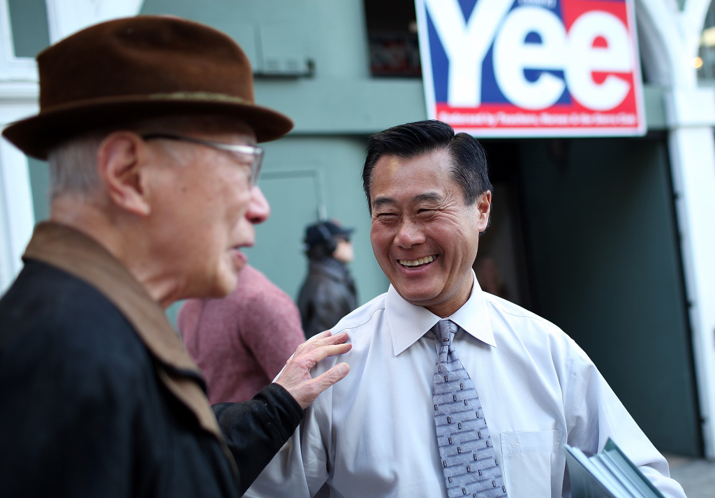 California State senator and candidate for San Francisco mayor Leland Yee greets a friend in front of his campaign headquarters on November 7, 2011 in San Francisco, California.