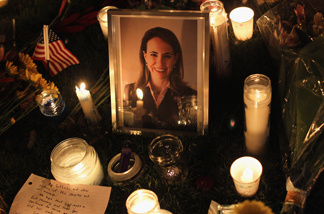 Candles surround a portrait of U.S. Rep. Gabrielle Giffords (D-AZ), who was shot January 8, 2011 in Tuscon, Arizona. Giffords was shot in the head at a public event entitled 'Congress on Your Corner' when a gunman opened fire outside a Safeway grocery store in Tucson. It was reported that eighteen people were shot, including members of Giffords' staff, and six are dead, including one young child. One suspect is in custody.