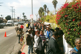 Thousands of people started lining up at 3 a.m. on Tuesday, Nov. 23, 2010 on Slauson Avenue in South Los Angeles for free turkeys at an annual event sponsored by Jackson Limousine Service.