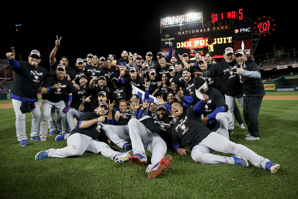 The Chicago Cubs celebrate during a team photo after the final out of Game 5 of the National League Divisional Series at Nationals Park on October 13, 2017 in Washington, DC.