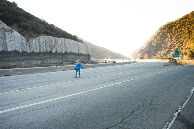Skateboarder Cindy Whitehead breezes down the 405 Freeway during Carmageddon II.