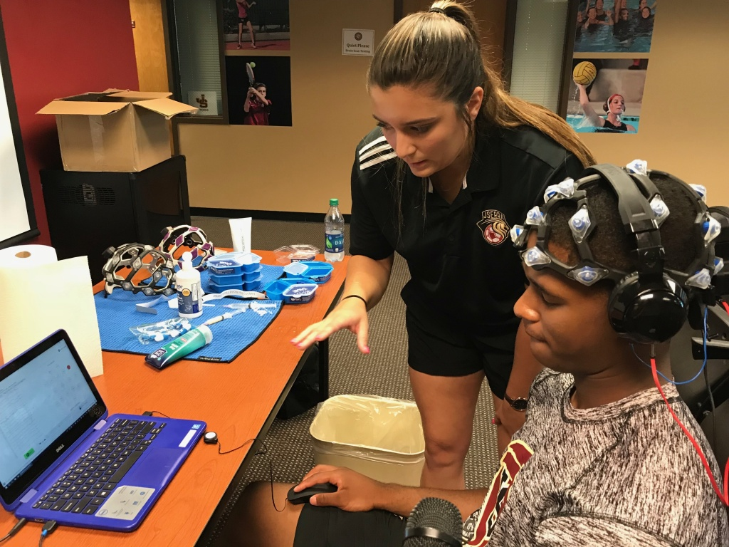 Munir McClain, 17, an incoming senior at JSerra High School, submits to a baseline brain scan administered by Erin Laswell.