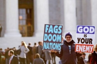 Fred Phelps, Jr., son of pastor Fred Phelps and a member of the Westboro Baptist Church, demonstrates outside the Supreme Court.