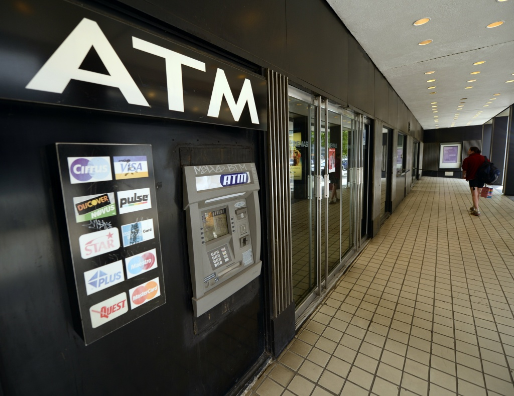 In this file photo, an ATM on Third Avenue is viewed in New York on May 10, 2013. Los Angeles City Attorney Mike Feuer warned Thursday of a rise in
