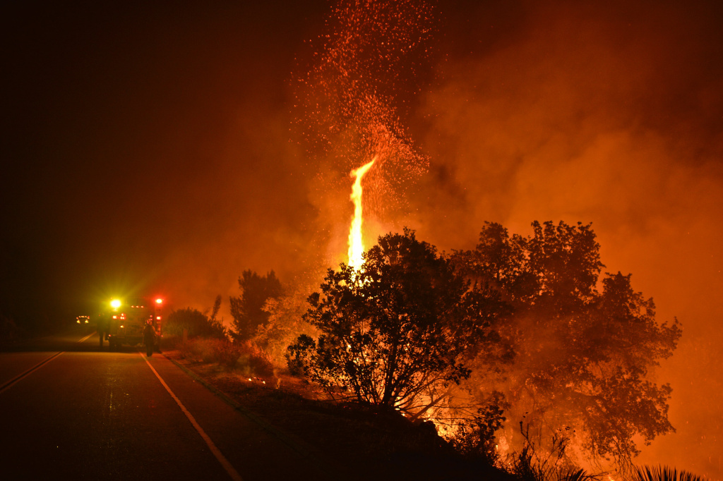 A tree torches at the Cabin Fire off Highway 39 in the Angeles National Forest Friday night.   The Cabin Fire burns Friday evening in the Angeles National Forest off Highway 39 August 14, 2015. The fire started Friday afternoon and destroyed multiple structures.