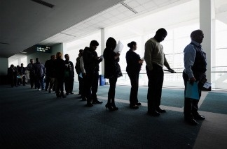 Job seekers line up to enter Choice Career Fair at the Los Angeles Convention Center on December 1, 2010.