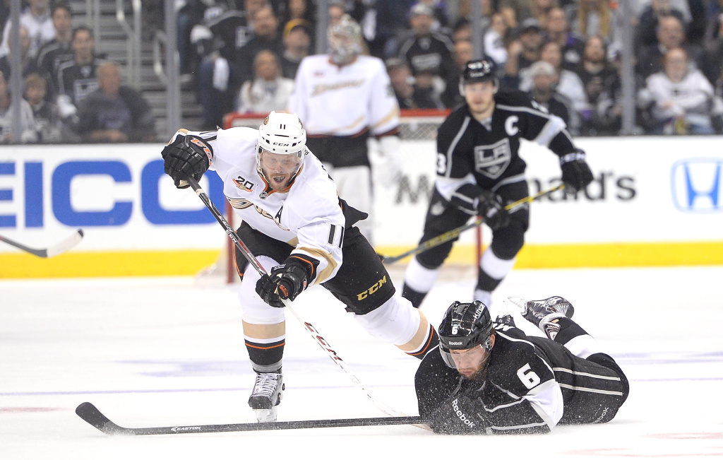 Saku Koivu #11 of the Anaheim Ducks chases after the puck as Jake Muzzin #6 of the Los Angeles Kings dvies during the first period in Game Four of the Second Round of the 2014 NHL Stanley Cup Playoffs at Staples Center on May 10, 2014 in Los Angeles, California.