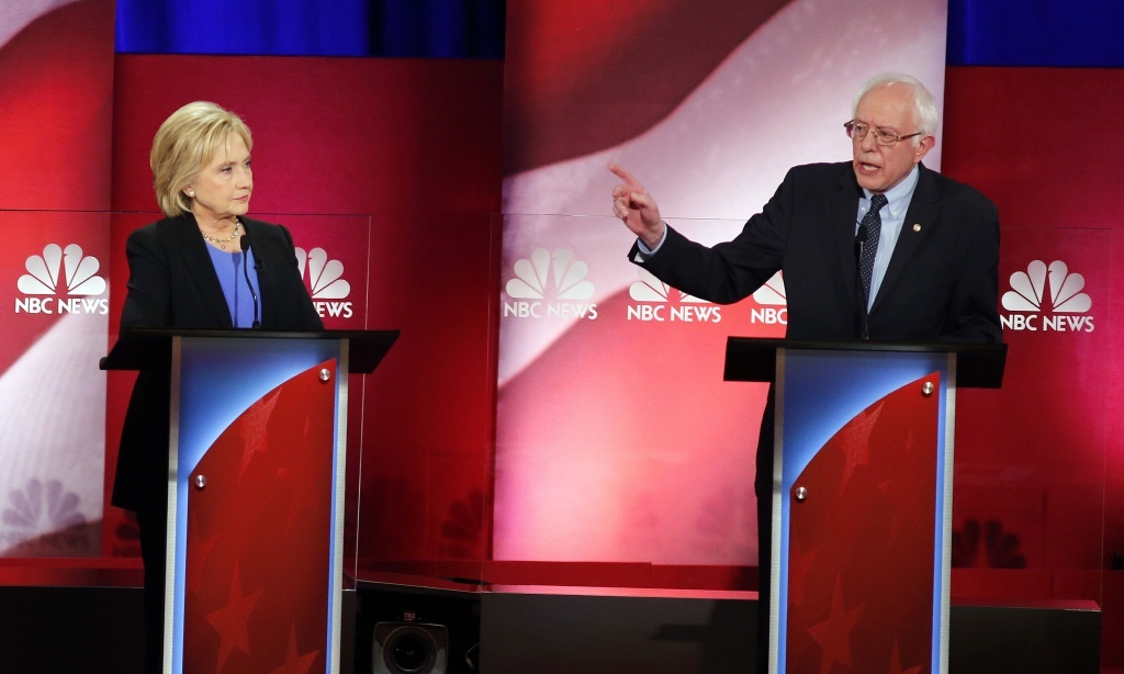 Democratic presidential candidate, Sen. Bernie Sanders, I-Vt., gestures towards Democratic presidential candidate, Hillary Clinton during the NBC, YouTube Democratic presidential debate in Charleston, S.C., on Sunday.