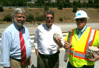 Metro CEO Art Leahy (L) with L.A. County Supervisor Zev Yaroslavsky (C) and Department of Transportation District 7 director Mike Miles (R) posing with pieces of the Mulholland Bridge during L.A.'s first
