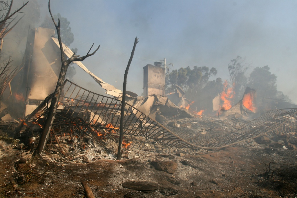 Fire burns close to homes off Malibu Canyon Road Oct. 21, 2007 in Malibu, California.