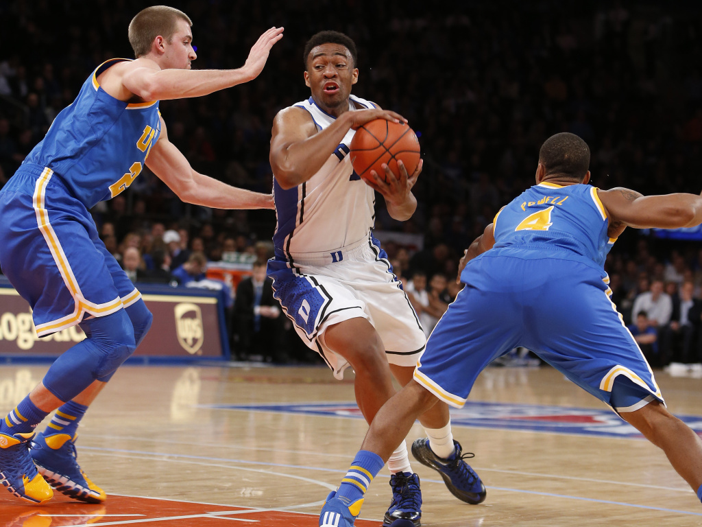 Duke's Jabari Parker weaves his way through UCLA players during a December game in New York.