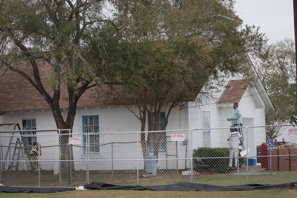 Workers patch bullet holes and paint the exterior of the First Baptist Church in Sutherland Springs, Texas, on Thursday after a gunman opened fire on Nov. 5, 2017, killing 26 people and wounding 20 others.