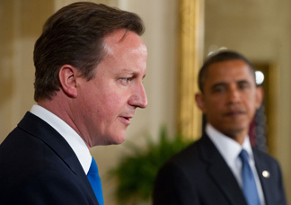 British Prime Minister David Cameron, left, speaks alongside US President Barack Obama  during a joint press conference in the East Room of the White House in Washington, DC, July 20, 2010. Prime Minister David Cameron ordered a review Tuesday of documents regarding the release of the Lockerbie bomber, but ruled out an inquiry into allegations of BP's involvement.