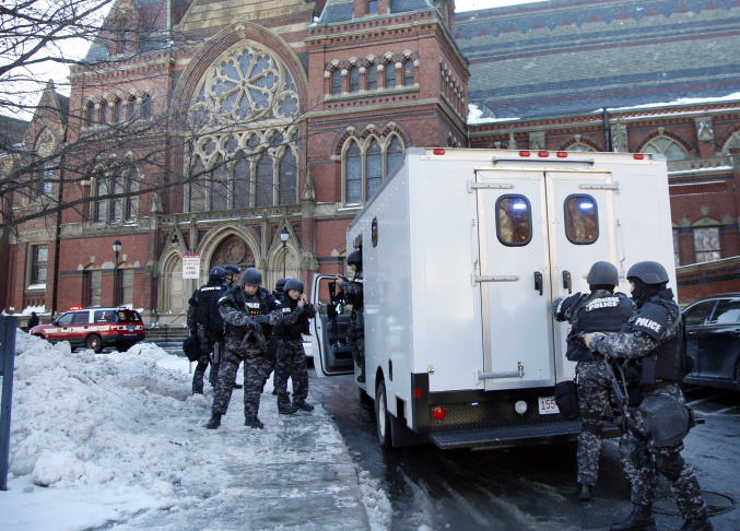 SWAT team officers arrive at a building at Harvard University in Cambridge, Mass., Monday, Dec. 16, 2013. Four buildings on campus were evacuated Monday after campus police received an unconfirmed report that explosives may have been placed inside, interrupting final exams.