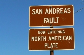 A sign marking the location of the San Andreas fault in California.